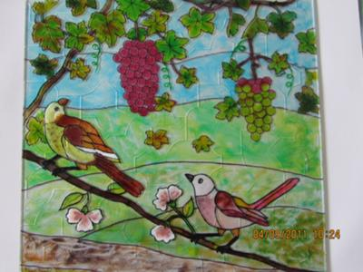 Birds on grapevine.