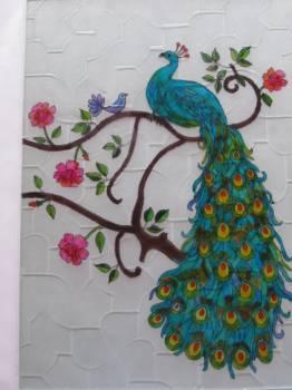 Peacock on glass